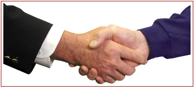 Photo two people shaking hands in Partnership.